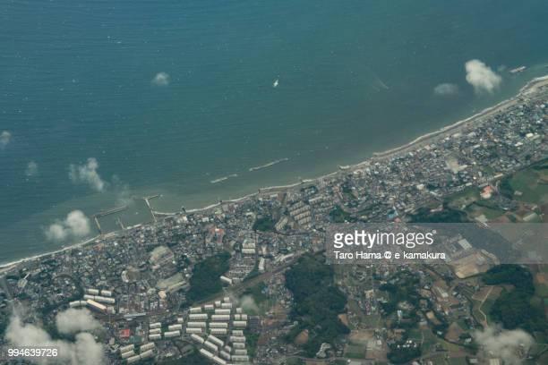 Tokyo Bay and Tsukuihama Beach in Yokosuka city in Japan daytime aerial view from airplane