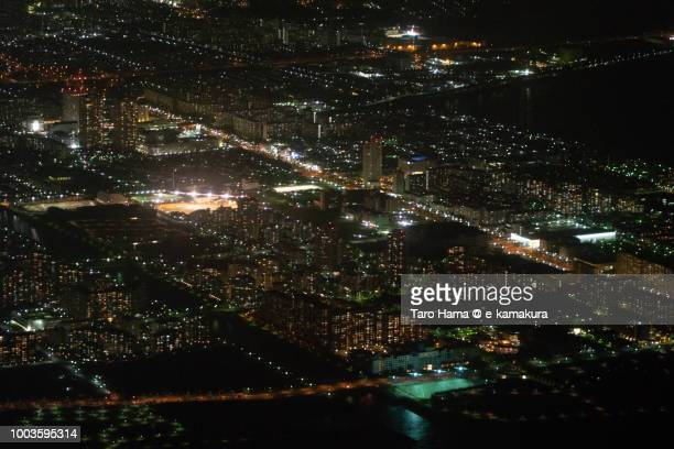 Tokyo Bay and Urayasu city in Chiba prefecture in Japan night time aerial view from airplane