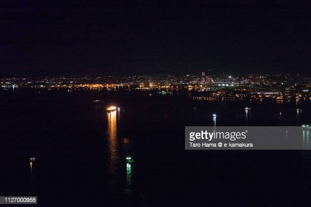 Tokyo Bay and Yokohama city in Japan night time aerial view from airplane