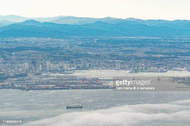 tokyo bay and yokohama city in kanagawa prefecture of japan aerial view from airplane - 横浜市 ストックフォトと画像