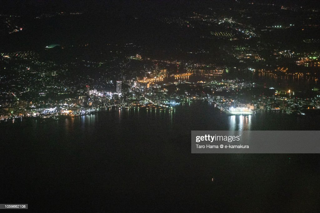 Tokyo Bay and Yokosuka city in Japan night time aerial view from airplane : ストックフォト