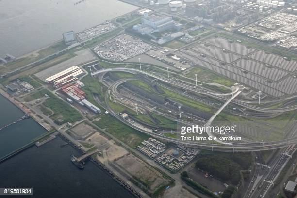 Tokyo Bay Aqua Line and Shuto Expressway intersection in Kanagawa prefecture sunset time aerial view from airplane
