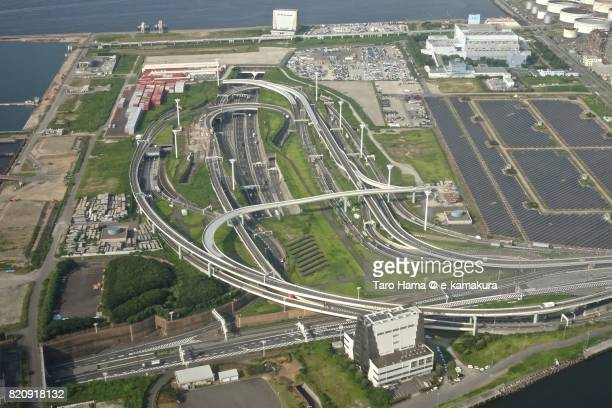 Tokyo Bay Aqua Line and Shuto Expressway intersection in Kawasaki city in Kanagawa prefecture day time aerial view from airplane