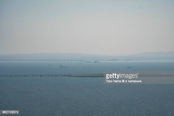 tokyo bay aqua line on tokyo bay and tokyo haneda international airport in tokyo in japan daytime aerial view from airplane - utc−10:00 stock pictures, royalty-free photos & images