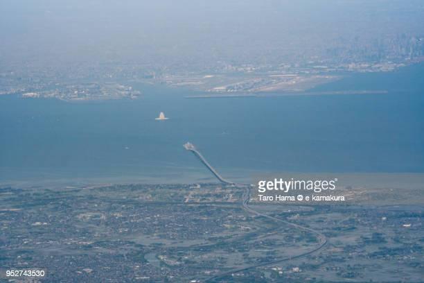 Tokyo Bay Aqua Line on Tokyo Bay, Kisarazu city in Chiba prefecture and Tokyo Haneda International Airport in Tokyo daytime aerial view from airplane