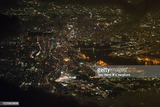 tokyo bay area and cityscape in japan night time aerial view from airplane - 関東地方 ストックフォトと画像
