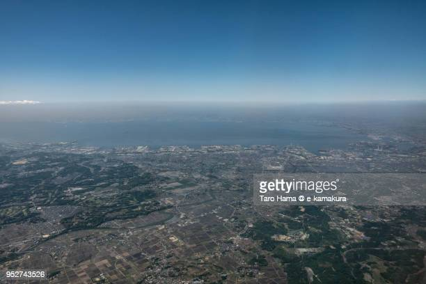 tokyo bay, ichihara and chiba cities in chiba prefecture in japan daytime aerial view from airplane - chiba city fotografías e imágenes de stock