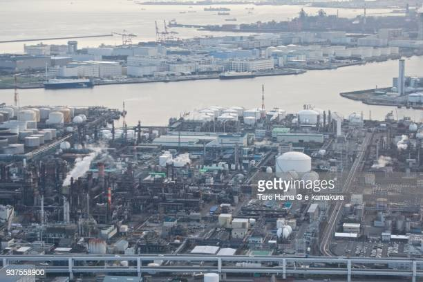 tokyo bay, oil stockpile bases and chimneys factory area in kawasaki city in kanagawa prefecture in japan daytime aerial view from airplane - kanagawa prefecture stock pictures, royalty-free photos & images