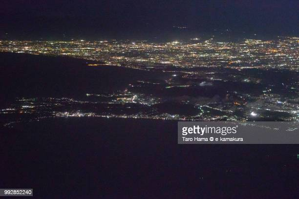 Tokyo Bay, Sagami Bay and Miura Peninsula in Kanagawa prefecture in Japan night time aerial view from airplane
