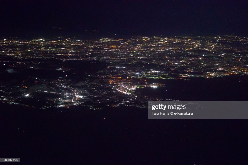 Tokyo Bay, Sagami Bay and Miura Peninsula in Kanagawa prefecture in Japan night time aerial view from airplane : ストックフォト