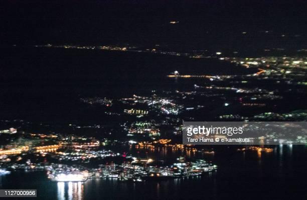 Tokyo Bay, Sagami Bay, and Yokosuka, Zushi, Kamakura and Fujisawa cities in Japan night time aerial view from airplane