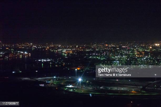 Tokyo Bay, Shuto Expressway and factory area of Kawasaki city in Japan night time aerial view from airplane