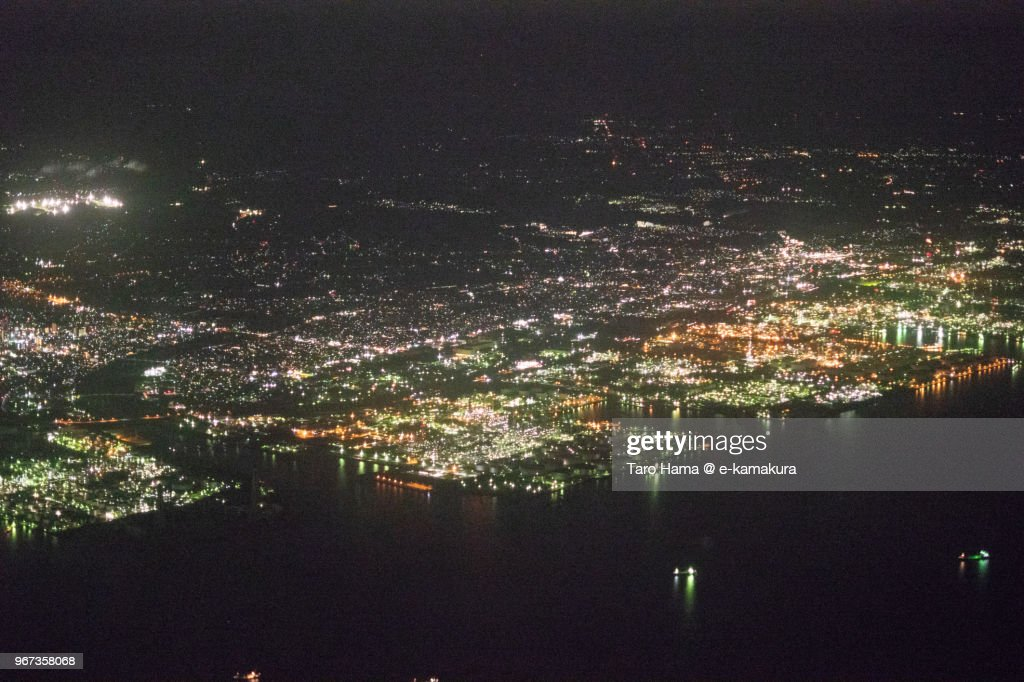 Tokyo Bay, Sodegaura and Ichihara cities in Chiba in Japan night time aerial view from airplane : ストックフォト