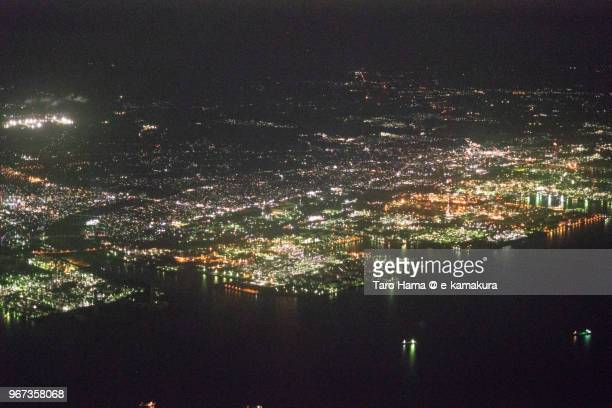 tokyo bay, sodegaura and ichihara cities in chiba in japan night time aerial view from airplane - 袖ケ浦市 ストックフォトと画像