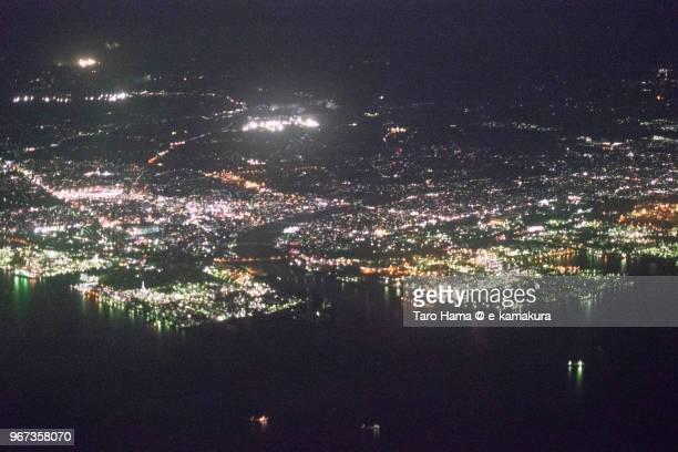 Tokyo Bay, Sodegaura and Ichihara cities in Chiba in Japan night time aerial view from airplane