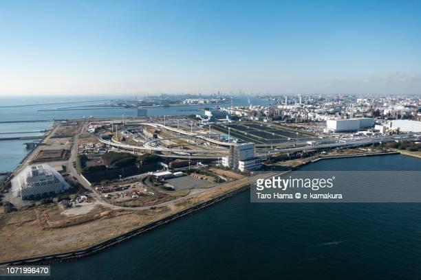 Tokyo Bay, Tama River and Kawasaki-Ukishima Junction in Kawasaki city in Kanagawa prefecture in Japan daytime aerial view from airplane