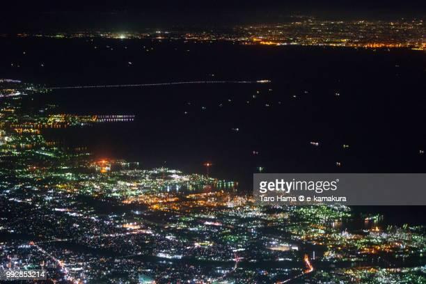 Tokyo Bay, Tokyo Bay Aqua Line, Chiba city and Yokohama city in Japan night time aerial view from airplane