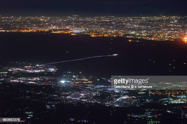 Tokyo Bay, Tokyo Bay Aqua Line, Kisarazu city in Chiba prefecture and Yokohama and Kawasaki cities in Kanagawa prefecture in Japan night time aerial view from airplane