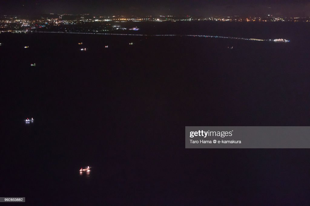 Tokyo Bay, Tokyo Bay Aqua Line, Kisarazu city in Japan night time aerial view from airplane : ストックフォト