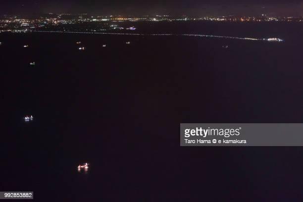 Tokyo Bay, Tokyo Bay Aqua Line, Kisarazu city in Japan night time aerial view from airplane