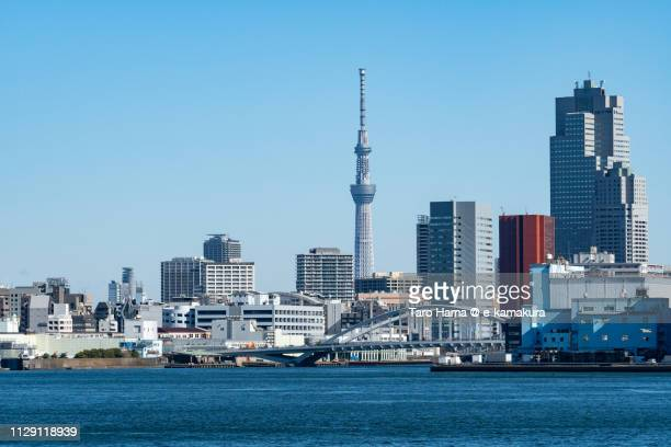 tokyo bay, tokyo sky tree and kachidoki bridge in tokyo in japan - tokyo japan stock pictures, royalty-free photos & images