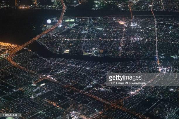 tokyo bay, urayasu city and edogawa-ku and koto-ku of tokyo in japan aerial view from airplane - chiba city fotografías e imágenes de stock