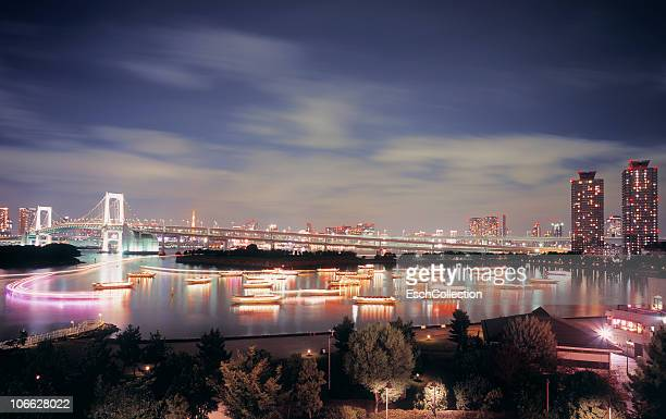 Tokyo Bay with boats and the Rainbow Bridge.