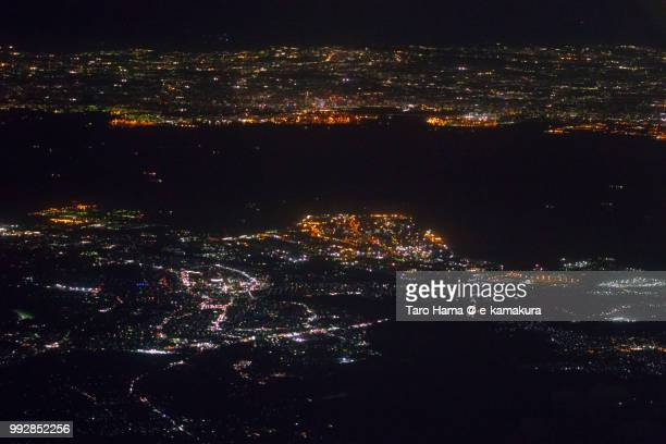 Tokyo Bay, Yokohama city in Kanagawa prefecture and Kimitsu and Futtsu cities in Chiba prefecture in Japan night time aerial view from airplane