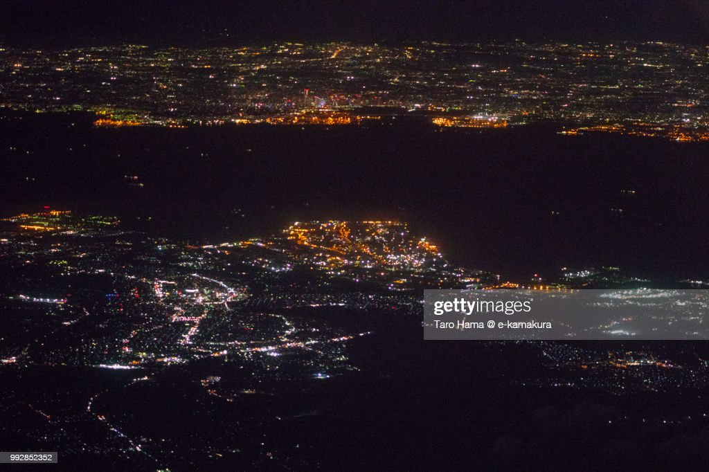 Tokyo Bay, Yokohama city in Kanagawa prefecture and Kimitsu and Futtsu cities in Chiba prefecture in Japan night time aerial view from airplane : ストックフォト