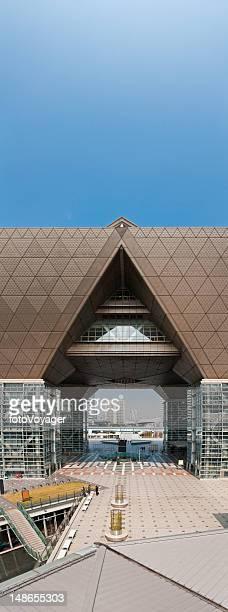 tokyo big sight exhibition centre plaza vertical panorama odaiba japan - tokyo big sight stock photos and pictures
