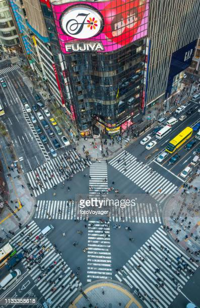 tokyo busy pedestrain crossing neon signs ginza aerial photograph japan - japan economy stock pictures, royalty-free photos & images