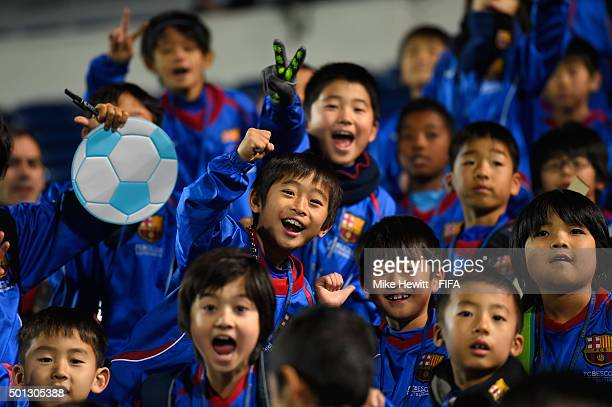 Tokyo children invited to watch a Barcelona training session in excited mood during the FIFA Club World Cup Japan 2015 at the Mitsuzawa Stadium on...