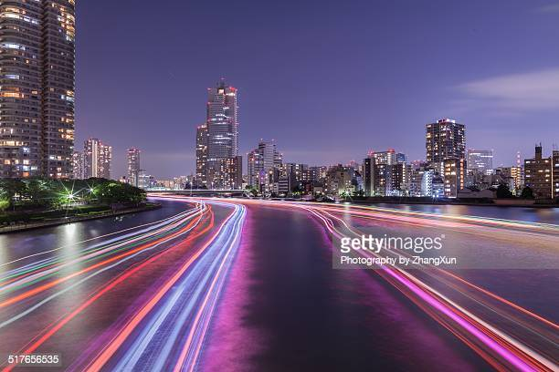 Tokyo city at dusk with Cruises light trails