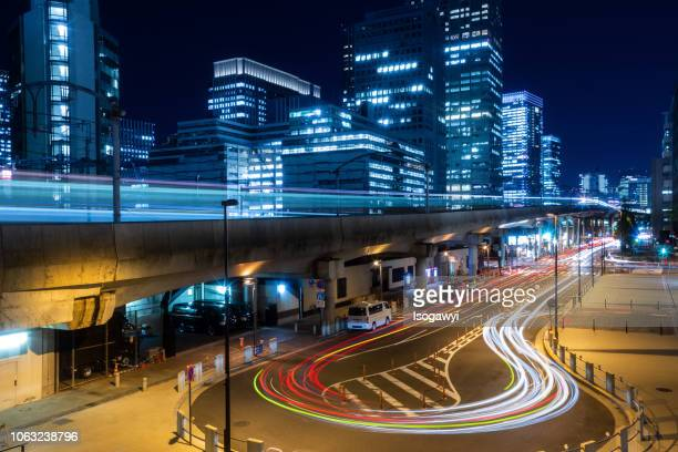 tokyo city skyline and traffic light trails at night - isogawyi stock pictures, royalty-free photos & images