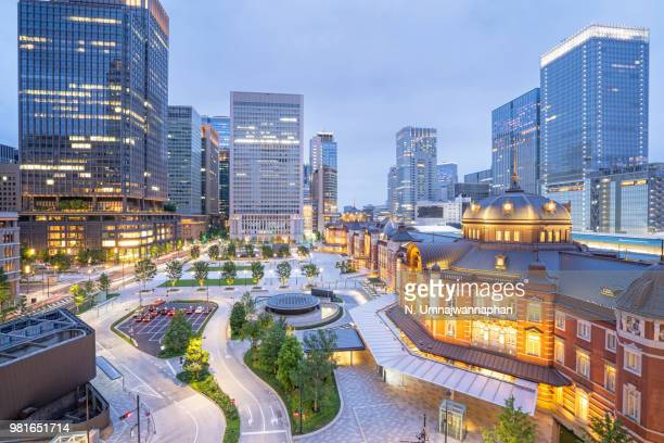 tokyo city view at tokyo station during twilight hour - hiroshima city stock photos and pictures