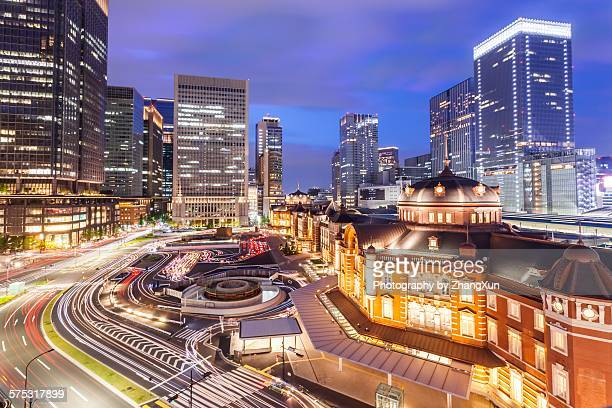 tokyo city with business street at night - tokyo station stock photos and pictures