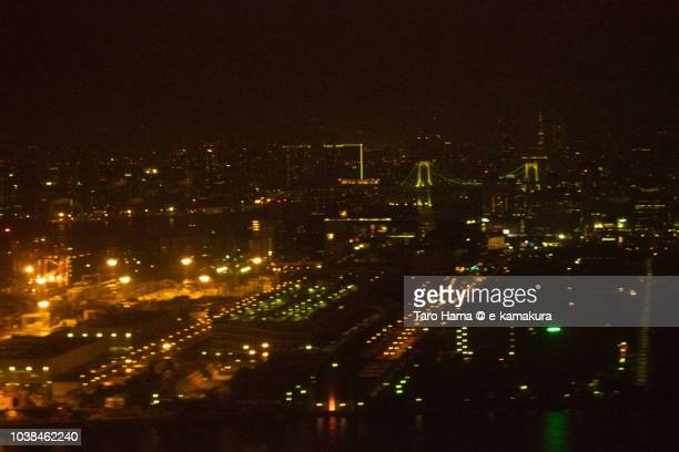 Tokyo cityscape night time aerial view from airplane