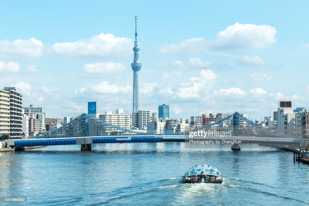 Tokyo cityscape over the Sumida River with Tokyo sky tree and Kiyosu bridge and cruise at day time, Tokyo, Japan. : Stock Photo