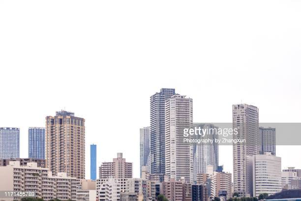 tokyo cityscape, skyscrapers skyline image at day time, japan. - オフィスビル ストックフォトと画像