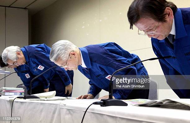 Tokyo Electric Power Co chairman Tsunehisa Katsumata and vice president Sakae Muto bow for apology during a press conference at their headquarters on...