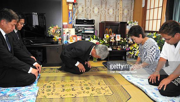 Tokyo Electric Power Co executive bows for apology to bereaved family of a male evacuee who committed suicide after being displaced due to the 2011...