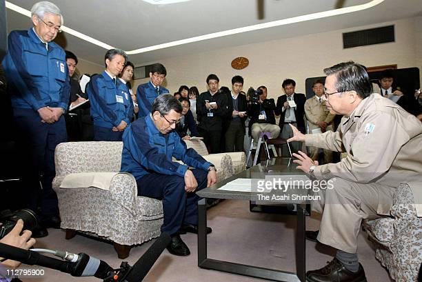 Tokyo Electric Power Co President Masataka Shimizu bows to Fukushima Prefecture Governor Yuhei Sato in apology for the crisis of the Fukushima...