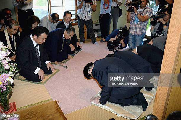 Tokyo Electric Power Co senior officers bow for apology to family members of Hamako Watanabe who committed suicide after the 2011 Fukushima Daiichi...