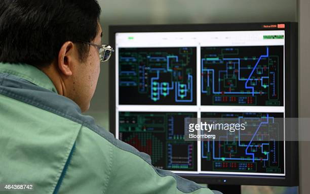 A Tokyo Electric Power Co's employee looks at a computer screen during a drill in the simulator of the central control room for a reactor inside the...