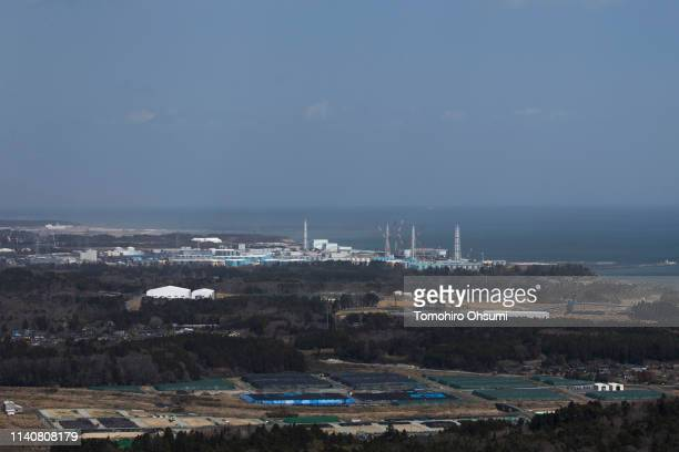 Tokyo Electric Power Co's Fukushima Daiichi nuclear power plant is seen from the Yonomori area on April 6 2019 in Tomioka Fukushima Japan The tunnel...