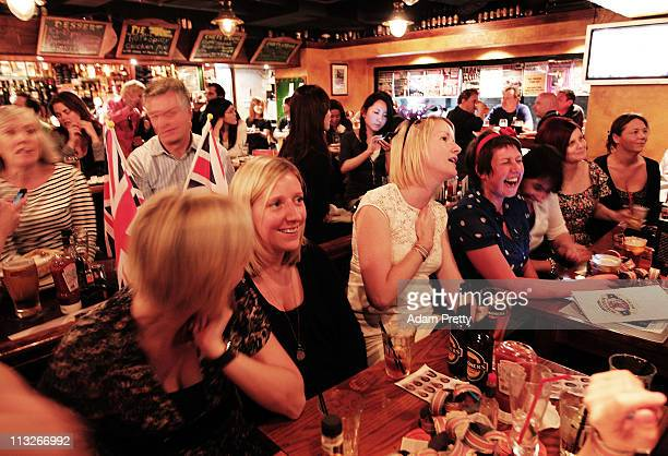 Tokyo expats watch the Royal Wedding of Prince William and Kate Middleton live on TV in the Hobgoblin British Pub in Shibuya on April 29, 2011 in...
