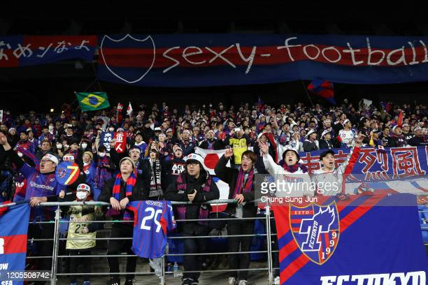 Tokyo fans cheer after the AFC Champions League Group F match between Ulsan Hyundai and FC Tokyo at the Ulsan Munsu Football Stadium on February 11,...