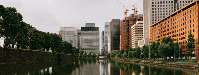 Tokyo financial district with imperial palace moat at sunset - gettyimageskorea