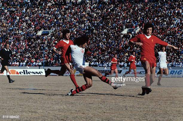 Forward Nunes scored third goal for Flamengo of Brazil while England's Liverpool goalkeeper Bruce Grobberlaar dives to the ball during the first half...