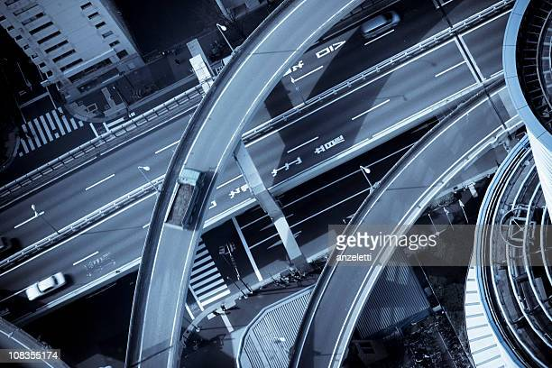 tokyo from above - overhead view of traffic on city street tokyo japan stock photos and pictures